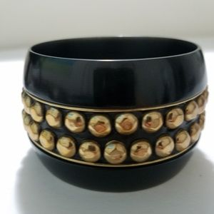 Jewelry - gold stud bangle made of wide black plastic